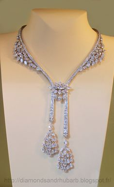 Diamond necklace with round, calibré-cut diamonds, and a diamond briolette drop. The opulence of this new collection is heralding a new age of elegance.