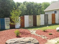 reuse old doors as a privacy fence
