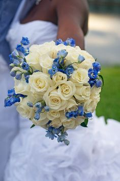 wedding bouquet white roses and blue.. This is the first bouquet I actually like for myself..