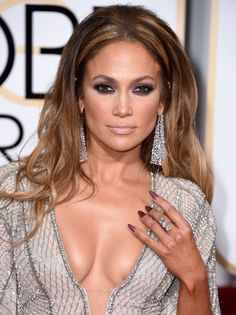 Pin for Later: Poll: Did J Lo Turn Up the Heat at the Globes Afterparty? She Finished Her Look With Long Dangling Earrings and a Smoky Eye