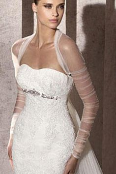Love this wedding dress with the shear bolero.
