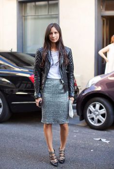 Shop this look on Lookastic:  http://lookastic.com/women/looks/biker-jacket-crew-neck-t-shirt-pencil-skirt-clutch-pumps/8419  — Black Quilted Leather Biker Jacket  — Grey Crew-neck T-shirt  — Grey Tweed Pencil Skirt  — Grey Leather Clutch  — Black Leather Pumps