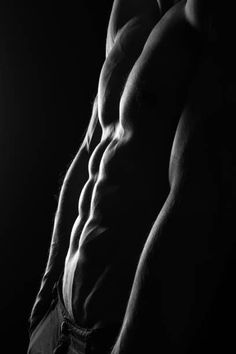sexy athletic male model with perfect six pack abs on black