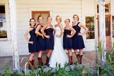 brown cowboy coots and mismatched navy bridesmaids dresses | Kick Up Your Heels Rustic Wedding | Lindsey Hahn Photography | Heart Love Weddings