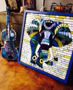 A personal favorite from my Etsy shop https://www.etsy.com/listing/261180695/tembo-stained-glass-mosaic-elephant