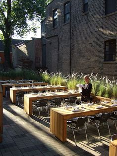 Raised planters with tall natural grasses add both greenery and ambiance to seating area                                                                                                                                                     More