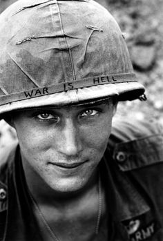 US Soldier with 'War is Hell' on Helmet, Vietnam by  Unknown Artist