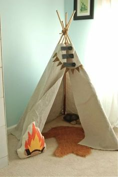 Teepee: The DIY teepee (get Michelles instructions on how to make your own here) comes complete with a faux fox fur rug and a campfire pillow, both of which Michelle also made.
