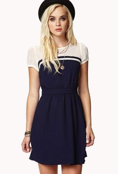 A chiffon colorblocked dress featuring a keyhole button closure at the back. Round neckline. Ruc...