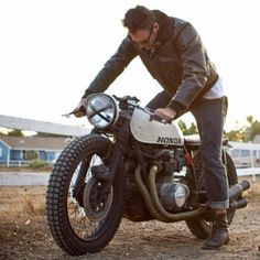 Kick it. An old school Honda cafe racer.