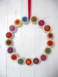 Colorful felt wreath by HetBovenhuis on Etsy, $49.99