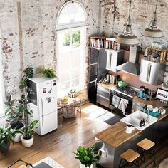 Converted warehouse makes for a stunning loft apartment. Exposed brick walls are… Converted warehouse makes for a stunning loft apartment. Exposed brick walls are soften with loads of indoor plants and timber furniture. House Inspiration, Home Interior Design, House Design, Timber Furniture, House Interior, Kitchen Styling, Industrial Style Kitchen, Exposed Brick Walls, Industrial House