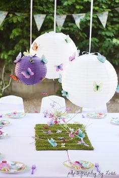 Butterfly Birthday Party Decor Ideas via lilblueboo.com.  <3 the purple lantern...and the centerpiece!!!  Wait til you see her cupcakes...
