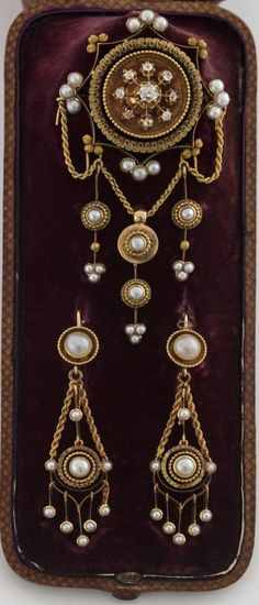 An antique gold, diamond and pearl demi parure, by Brissac et Portal, Paris, 1868-1870. Comprising a brooch and a pair of ear pendants.