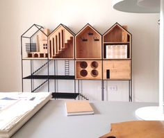 """Shaped like houses, a dinnerware storage cabinet, named after the Thai word for """"home,"""" exudes warmth and good cheer while presenting the perfect place for everything. Pet Furniture, Design Furniture, Kitchen Furniture, Wooden Furniture, Furniture Ideas, Design Awards, Little Houses, Shelving, Storage Shelves"""