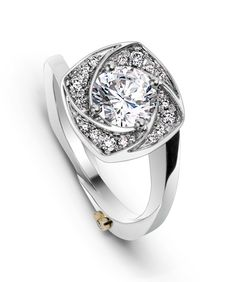 The Flutter engagement ring contains 25 diamonds, totaling 0.145ctw. Center stone sold separately, not included in price.