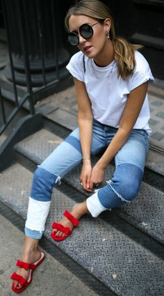 patchwork high rise medium wash skinny jeans, red bow slide sandals, basic white crewneck tee with rolled short sleeves, round oversized retro sunglasses // H&M, rebecca taylor