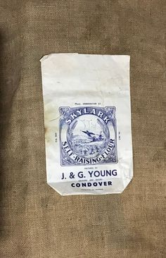 "Dating from the early 20th century a charming unused paper flower bag for J & G Young grocers and bakers of Condover Shropshire. The evocative picture showing corn sooks, a windmill and beautiful countryside reminds of a Britain long ago. Ideal for framing and hanging in the kitchen.Measures 7.1/2"" x 12"" (190 x 30.mm). Flower Bag, Wood Turning, Windmill, Paper Flowers, Countryside, Britain, Dating, Victorian, Antiques"