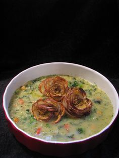 Lotus.raw.vegan.living original* Amazing what a few potatoes, a bunch of celery, chopped veggies and some creativity will produce! <3 Introducing my organic cream of celery soup with petit potato roses.