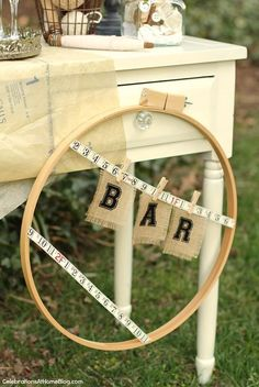 Ideas for a Vintage Sewing Themed Bridal Shower / Seen here: hoop bar sign // Celebrations at Home