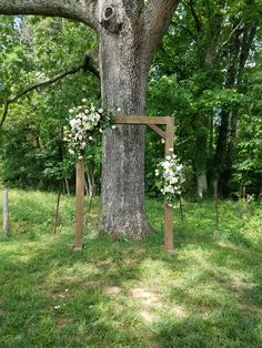 Light brown arbor with white flowers