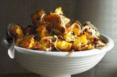 Twice-roasted potatoes with onion, herbs and chilli - These golden potatoes are first baked whole, then torn into chunks so they become wonderfully crisp all over yet stay fluffy inside. Chilli Recipes, Potato Recipes, Italian Recipes, Vegetarian Recipes, Cooking Recipes, Potato Dishes, Savoury Recipes, Chilli Food, Christmas Recipes