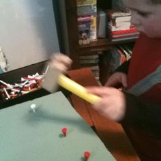 A piece of foam, golf tees, and a hammer = a busy 2 year old!