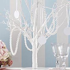 Pearl Garland Wedding Table Decoration - wedding centerpiece http://www.uniqueweddingfavours.co.uk/weddingfavours/Pearl-string-wedding-decoration-1353.html