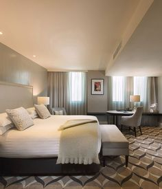 Mayfair Hotel, Adelaide  Interior design by Bates Smart picks up bold, oblong Art Deco lines, defined by glossy black, stark white and cool slate colours, framing cut-crystal lamps and bold mirrors.  #TravelGuide #Adelaide #TravelNews #HotelNews