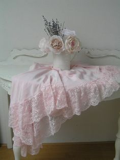 pink lace, white table, and pink roses