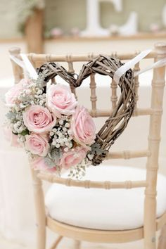 Pink roses and babys breath heart chair decor  http://merrybrides.tumblr.com/