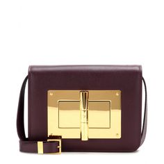 Tom Ford - Natalia Medium leather shoulder bag - Tom Ford's boxy 'Natalia' bag comes finished with gold-tone embellishment and a twist-lock mechanism. We love the rich, deep, dark burgundy colour. Use the detachable strap to sling it over one shoulder or carry it in your hand as a sizeable statement clutch. seen @ www.mytheresa.com