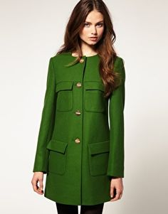 ASOS Minimal Coat With Gold Buttons  $165.25  Button through coat, featuring a scoop neckline, collarless design, single breasted button through closure to the front with embossed detailing, four covered patch pockets to the front and a panelled finish to reverse.