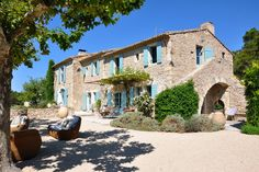 stone home with blue shutters // Provence, France