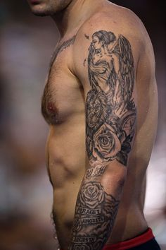 #RIO2016 A swimmer's tattoo is pictured during a training session on August 5 2016 in Rio de Janeiro a few hours ahead of the opening ceremony of the Rio 2016...