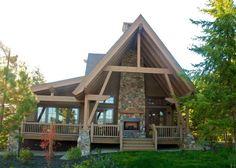Davis Peak Timber Frame Porfolio - I like the outdoor fireplace on the porch