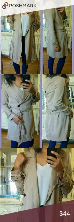 ?NEW?TAN LIGHTWEIGHT TRENCH JACKET COAT Love the feel of this trench. It's lightweight. Has a removable tie at waist. Buttons at cuffs. Inner single button closure. Just love it. Taupe color.  Sizes available : S M L  ?Modeling ? size Medium.  ?Bundle and Save. JMAY4354 Jackets & Coats Trench Coats