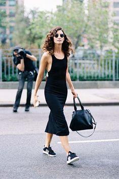 Lily Aldridge in a black bodycon midi dress + sneakers