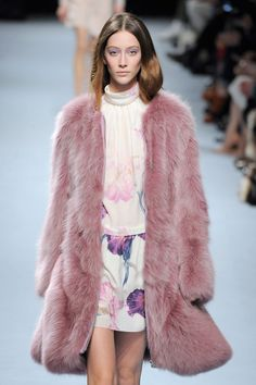 One very romantic look from @Nina Ricciat #PFW - a dusted rose fur coat over floral prints, teamed with a violet eyeshadow has us feeling al...