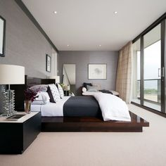 Bedroom. Contemporary minimalism. I'm surprised how great the warm beige carpet looks with a textured gray wall.