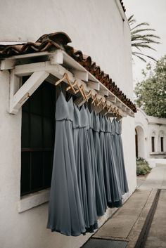 Soft grey bridesmaids dresses set on custom monogrammed hangers ready for this California Wedding. Photo by Feather + North and Erin Northcutt. Wedding Planning by Bella Baxter Events #weddingdress