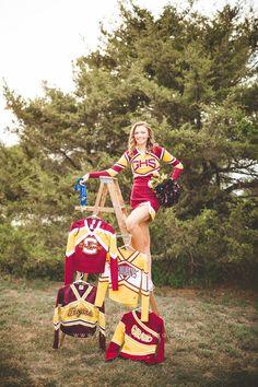 Kansas High school senior girl portrait in cheer uniform and all-star medals during the golden hour. Cheerleading Senior Pictures, Dance Senior Pictures, Senior Cheerleader, Cheer Team Pictures, Cheer Picture Poses, Unique Senior Pictures, Cheer Poses, Senior Photos Girls, Senior Girls