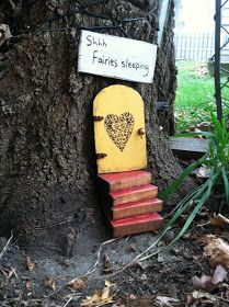 Fairy garden set of includes yellow fairy door, a set of stairs, and a sign