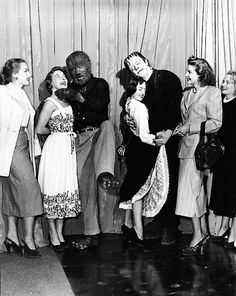 "Frankenstein (Glenn Strange) and The Wolf Man (Lon Chaney, Jr.) find a couple of girls to dance with during the production of ""Abbott and Costello Meet Frankenstein"" 1948 [By prev. Frankenstein's Monster, Monster Party, Monster Mash, Monster Squad, Hollywood Monsters, Lon Chaney Jr, Abbott And Costello, Horror Monsters, Funny Monsters"