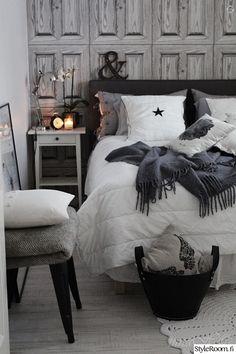 makuuhuone,tapetti,kodintekstiilit,tekstiilit,yöpöytä,viltti,torkkupeitto,kori,lakanat,sänky