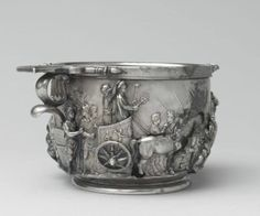 a) scyphus (drinking cup) b) silver c) boscoreale, now in louvre d) ca15-20ce e) similar to scyphus w aug, this side shows tib riding in a quadriga being crowned and reminded he's only mortal during triumph (had 2 - germans in 7bce and illyrians in 12bce), other side shows tib sacrificing to jupiter capitolinus
