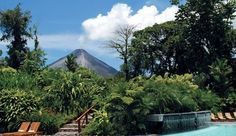 Tabacon Grand Spa: Tabacon's pool, Jacuzzi and water slide have clear views of the Arenal Volcano. #JSVolcano >> I would go back to Costa Rica any day! Lovely country with such wonderful people!