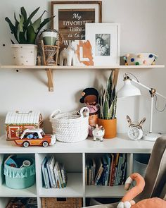 Organizing toy clutter & cute ways to decorate and style kid's room's shelves and the Ikea Kallax shelving unit.