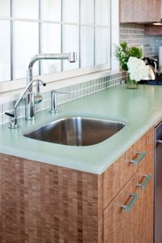 Bio-Glass  Bio-Glass, another recycled glass countertop material with Cradle to Cradle certification, has an ethereal, translucent appearance, as it's made of 100 percent glass. As with all glass-based counters, it's not knife friendly, so keep your cutting boards handy.