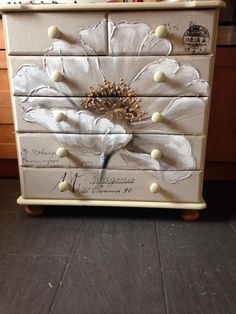 A thrift shop dresser painted in Chalk Paint then decoupaged an oil canvas to this dresser.  Just wonderful!!!
